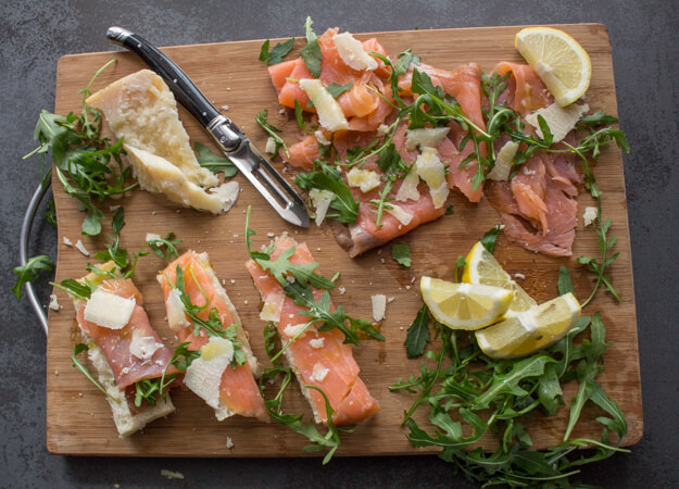 Smoked Salmon Rucola (Arugula), a healthy fast & easy Italian appetizer recipe. Topped with Parmesan flakes & drizzled with olive oil.