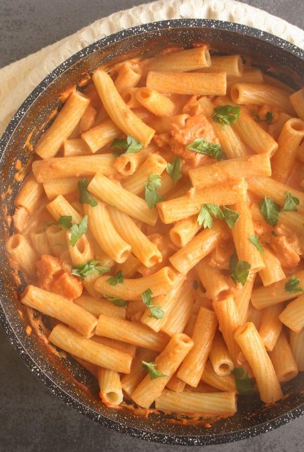 cream sauce with rigatoni pasta in a black pan