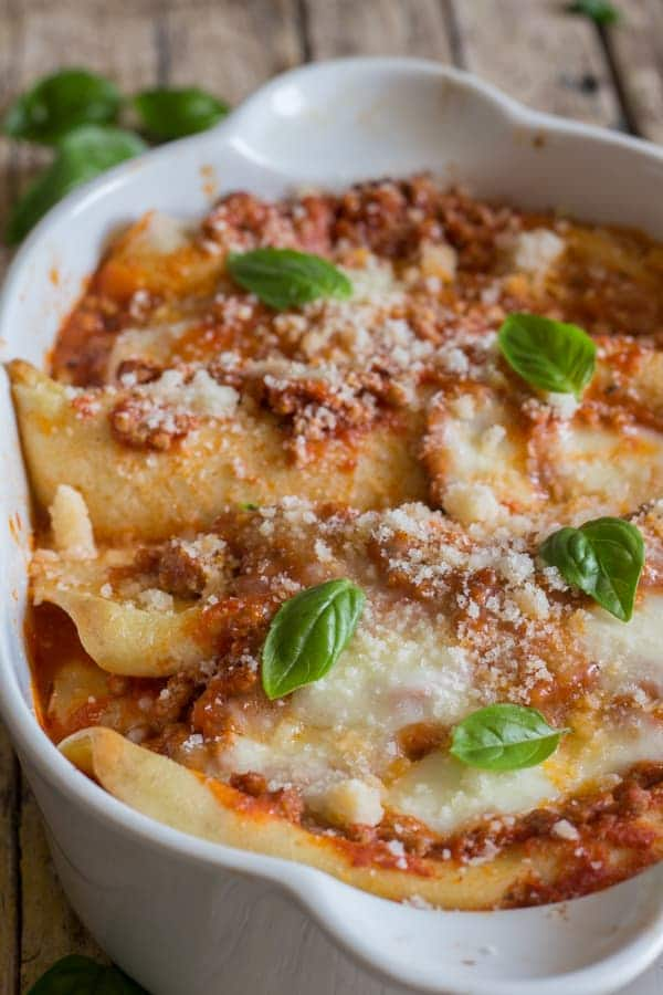 baked crepe cannelloni in a white dish