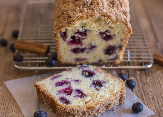 blueberry streusel loaf on a wire rack