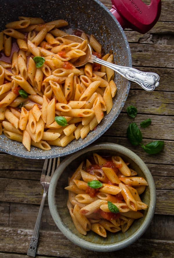 Easy tomato sauce with pasta in a bowl and in the pan