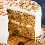 carrot cake on a wooden plate