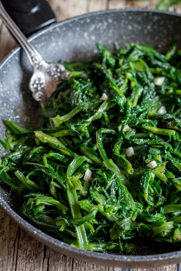 chicory greens in a black pan