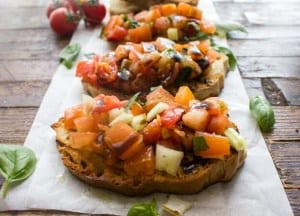 Easy Classic Tomato bruschetta, a simple delicious healthy dinner appetizer made with fresh tomatoes, basil,olive oil & balsamic glaze.