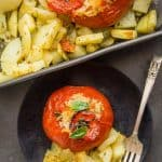 Baked Tomatoes Stuffed with Rice, a delicious Italian Recipe, whole tomatoes stuffed with a perfectly spiced rice and roasted potatoes.