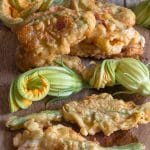 zucchini flowers on a wooden board
