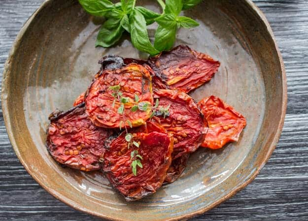 Oven Dried Tomatoes, how to make Homemade Oven Dried Tomatoes delicious and easy, tossed with olive oil and fresh spices. Gluten free.