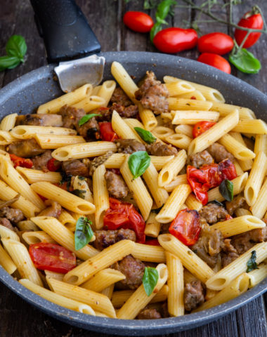sausage pasta in a black pan