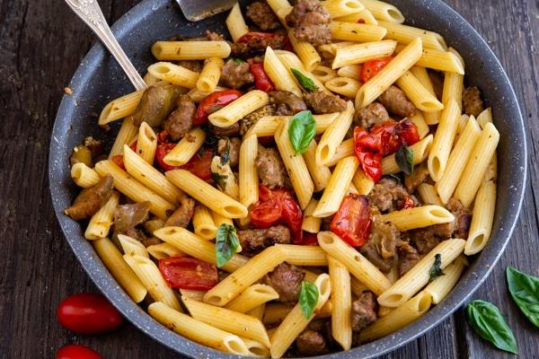 sausage pasta in a black pan