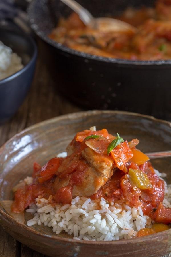 chicken cacciatore in a dish over rice