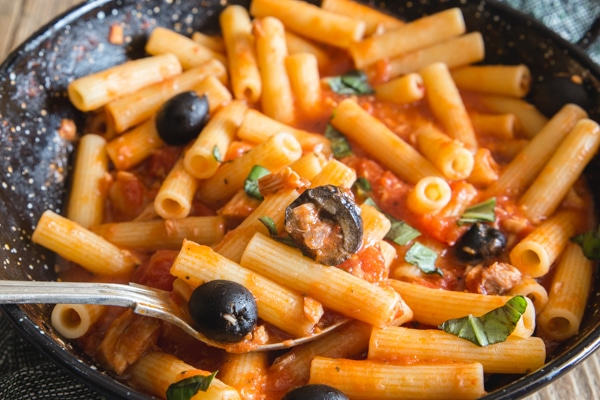 tuna and olive pasta in a black pan