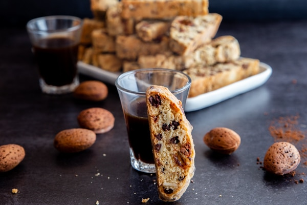 a biscotti leaning against an espresso