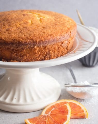 coconut orange cake on a white stand