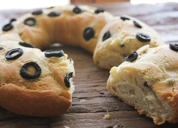 olive bread recipe baked with a slice cut