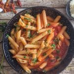 penne arrabbiata in a black pan