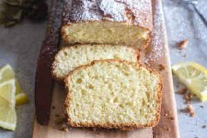 plumcake with 2 slices on a board
