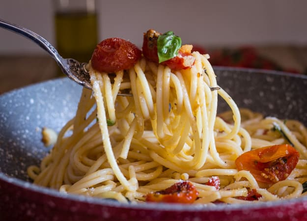 a fork of spaghetti with oven dried parmesan tomatoes