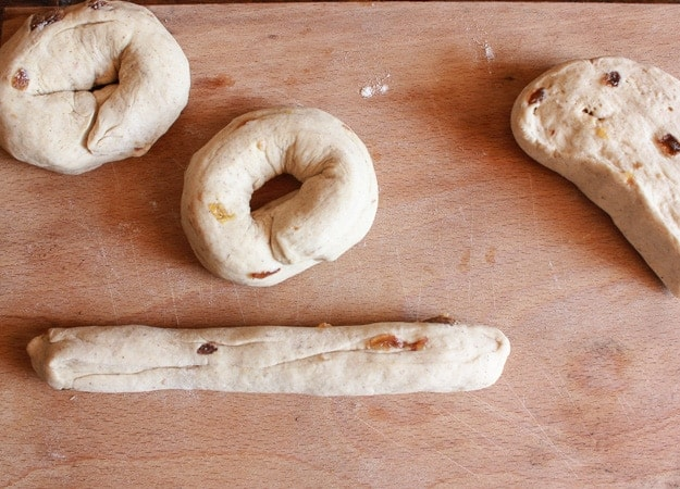 forming the dough in bagel shapes and 1 rope with remaining dough on the board