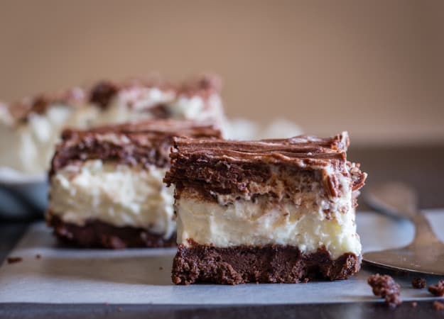 nutella crumb double chocolate cheesecake squares on a board
