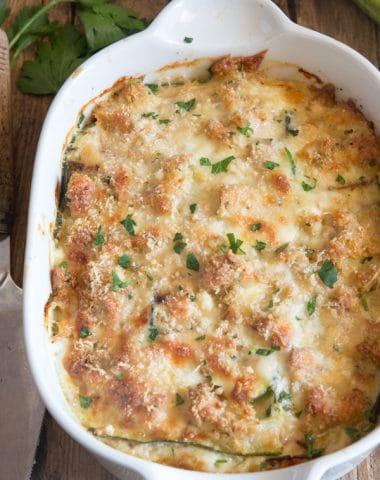 zucchini casserole in a white baking dish