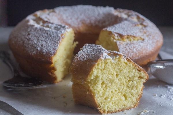 a piece cut of fresh cream lemon cake