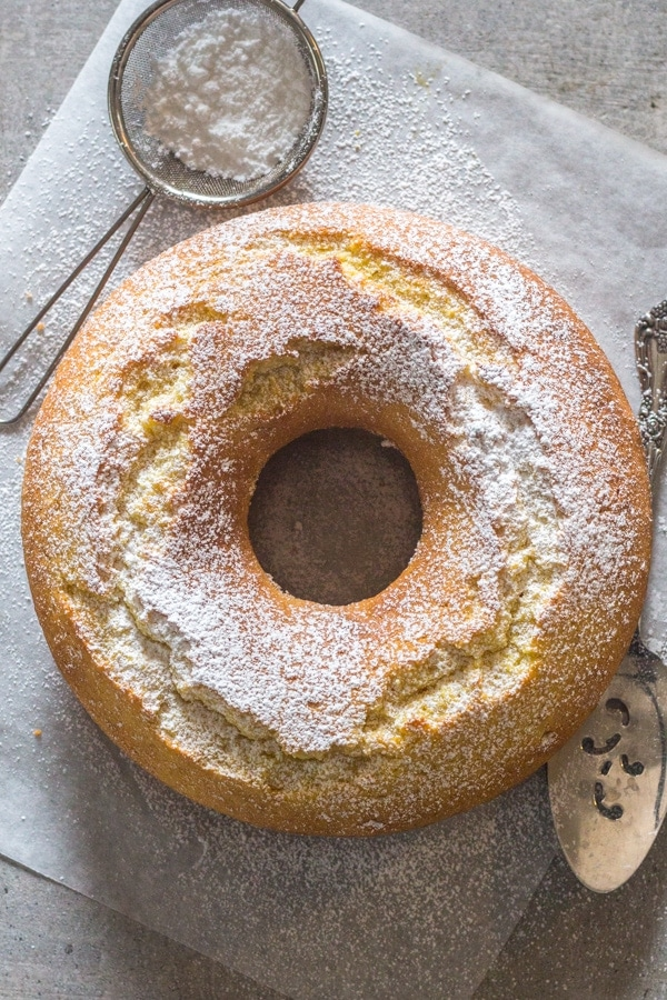 lemon cake on a white board sprinkled with powdered sugar