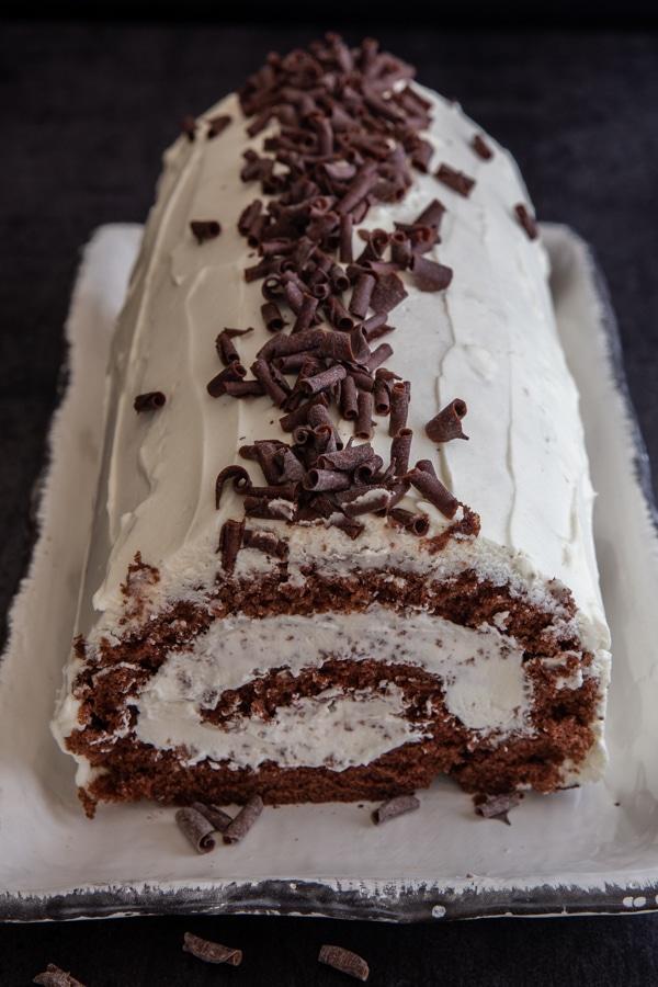 tiramisu roll cake on a white plate