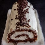tiramisu roll cake on a white plate