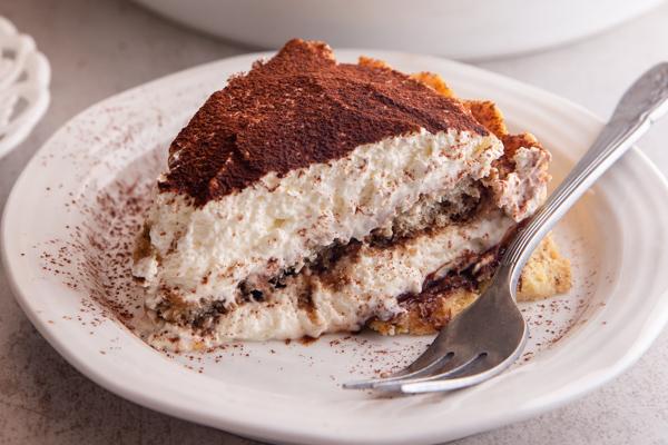 a slice of tiramisu pie on a white plate