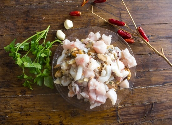 Easy Italian Fish Soup, a fast, healthy Italian soup. Full of fish,cod and seafood, the perfect family dinner, spicy or not.