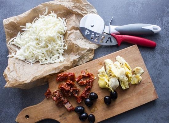 Italian Sausage Artichoke Cheese Pizza, pre-made or homemade dough, fast and easy. A healthy Italian white pizza recipe.