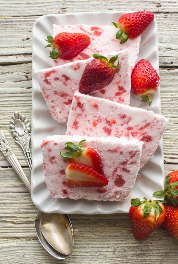 A fast and easy no-bake dessert, Creamy Strawberry Semifreddo. Made with greek yogurt, cream and strawberries. A Perfect summertime recipe.