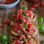 bruschetta with tomato on a wooden board