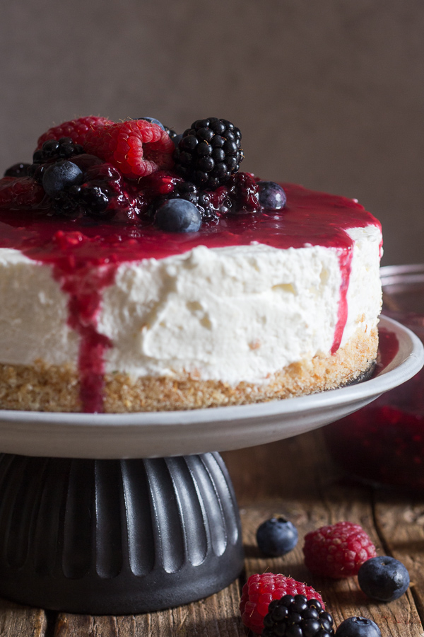 no bake cheesecake on a black & white cake stand