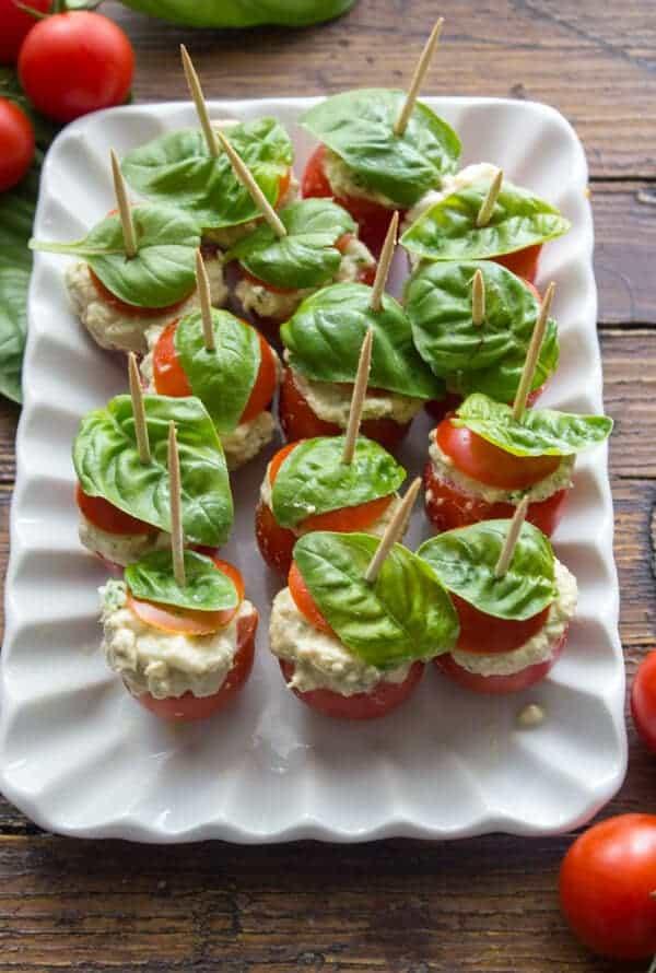 Tuna Mozzarella Stuffed Cherry Tomatoes, a quick and easy creamy tuna mozzarella appetizer recipe. A healthy bite size serving. Delicious.