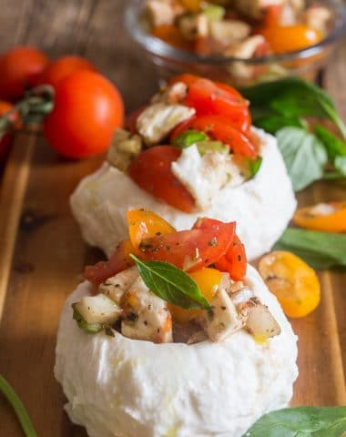 stuffed fresh mozzarella caprese on a board