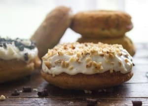 Homemade fast and easy Healthy Baked Zucchini Cake Donuts. Made with zucchini and greek yogurt. Add a delicious light Cream Cheese Frosting.