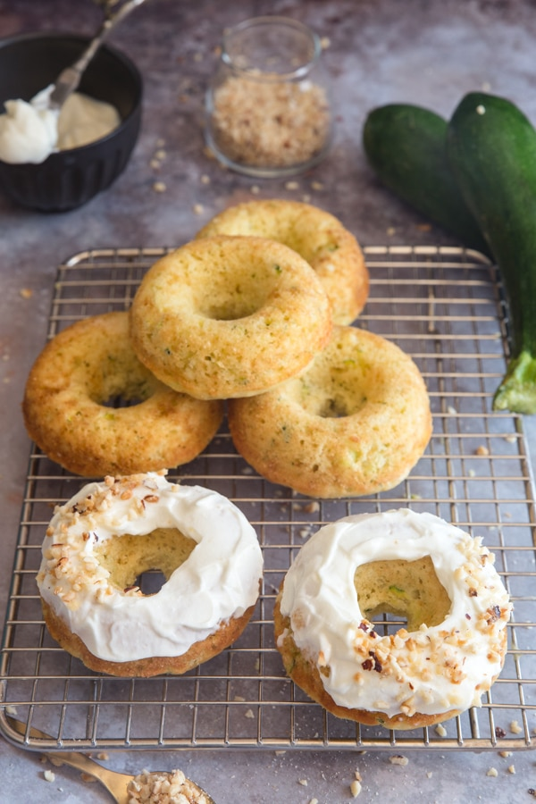 zucchini baked donuts on a wire rack