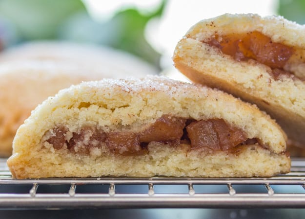 open apple pie cookies on a rack