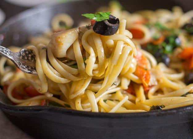 a forkful of italian baccala linguine