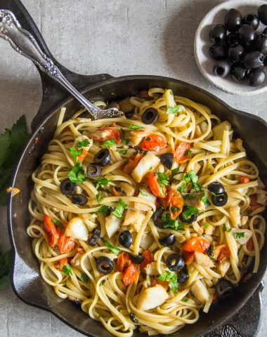 baccala linguine in a black skillet