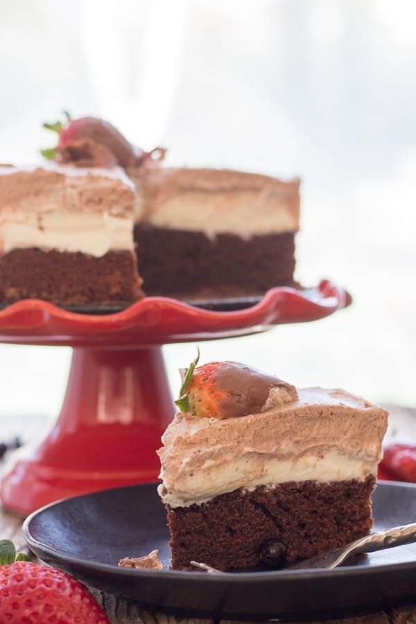 chocolate mousse cake on a red cake stand