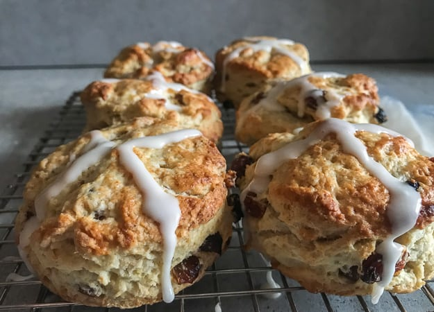 hot cross scones on a wire rack