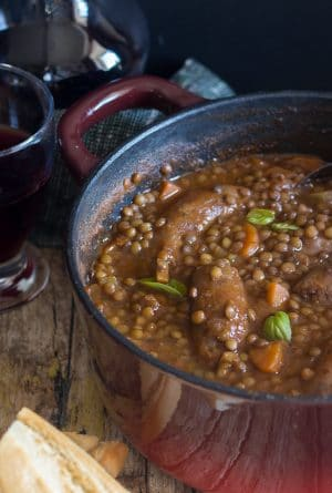 lentils sausage stew in a red pot