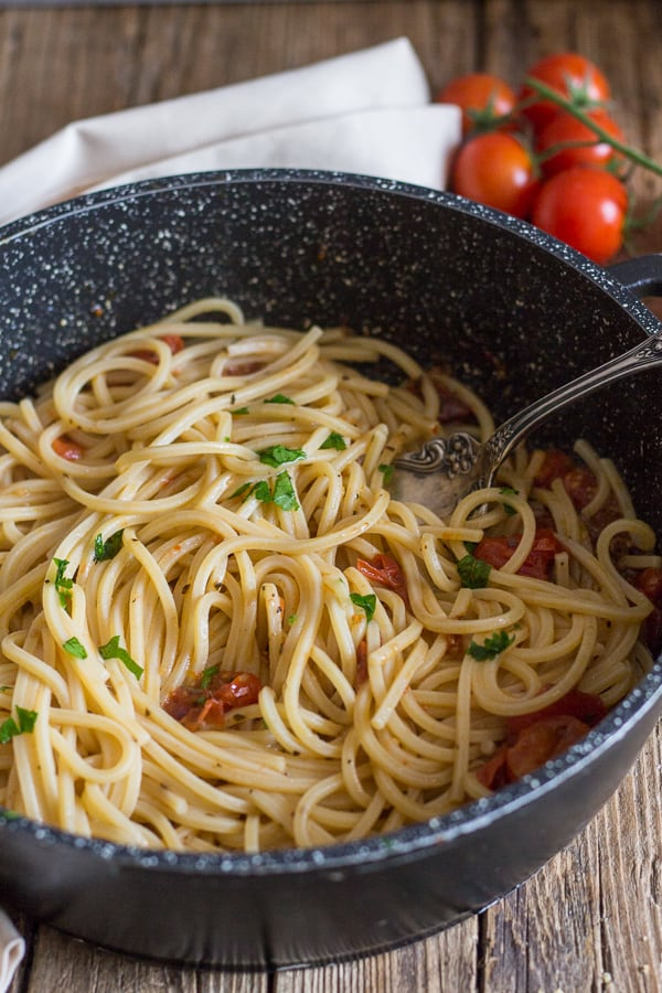 anchovy pasta in a black pan