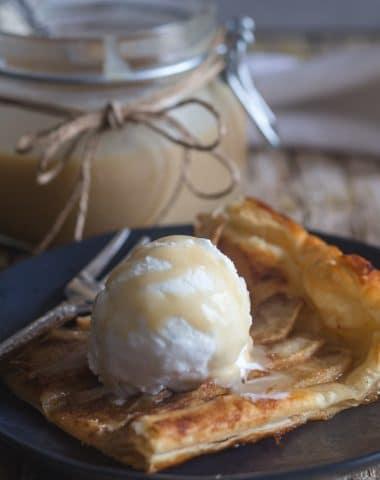 apple tart slice with vanilla ice cream and caramel sauce