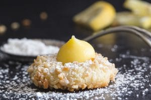 lemon thumbprint cookie dusted with powdered sugar