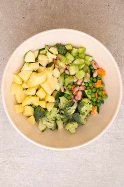 chopped vegetables in a white bowl