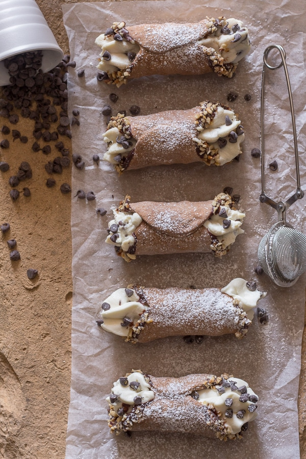 5 cannoli on a board