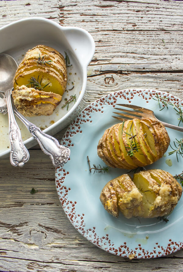 Easy Baked Italian Spiced Parmesan Hasselback Potatoes, the perfect side dish Potato recipe, perfectly spiced and cheesy.